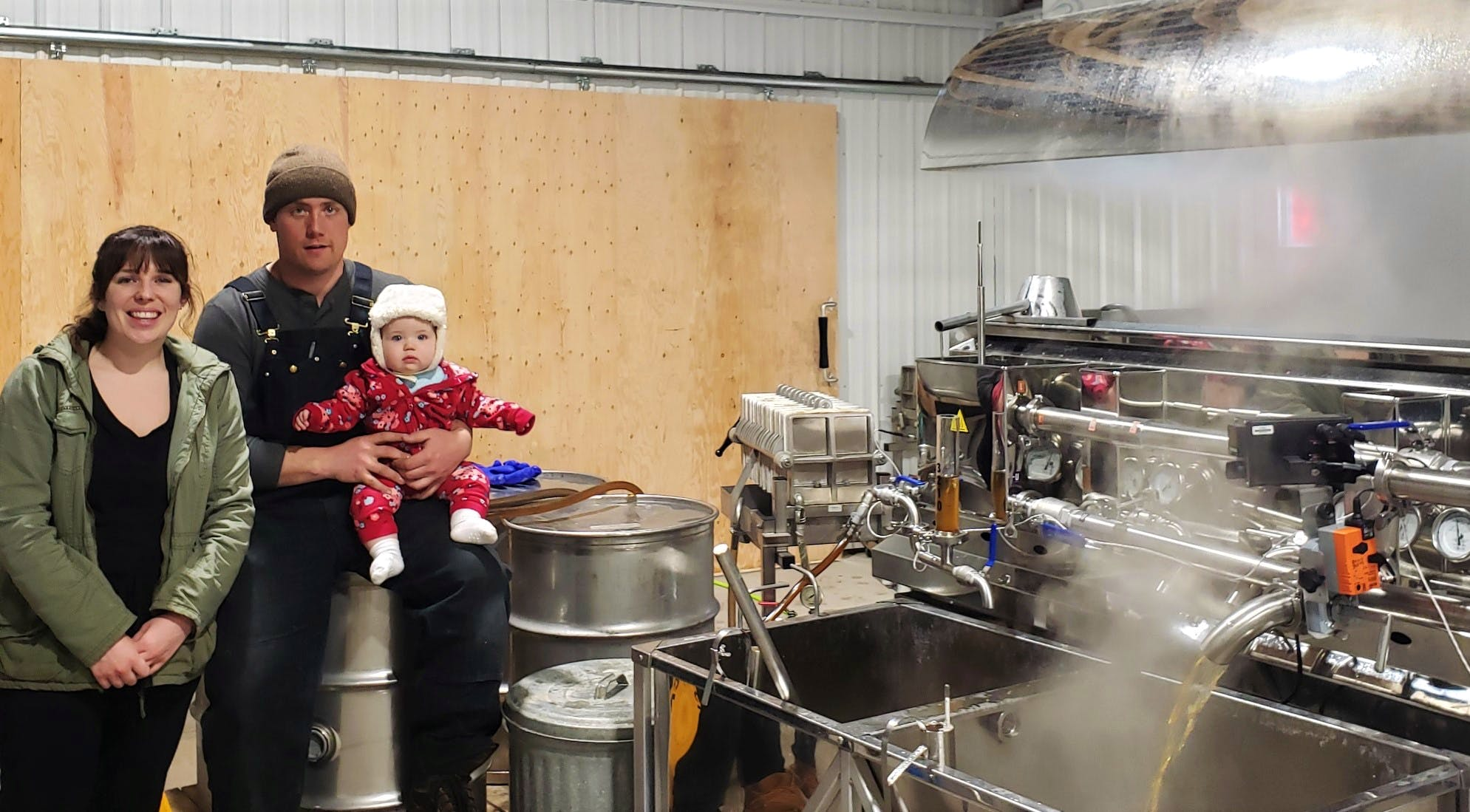 """Meet the McCormick family! Brad is the 6th generation to harvest maple from his great, great, great Granddad's sugar bush in Rodney, Cumberland County, NS.  He and his father, Kevin McCormick and their fellow members of the Maple Producers Association of Nova Scotia, keep Acadian Maple Products well-stocked in maple. Let's hope the passion for maple """"runs"""" in the family and that little Graci will keep the tradition going."""
