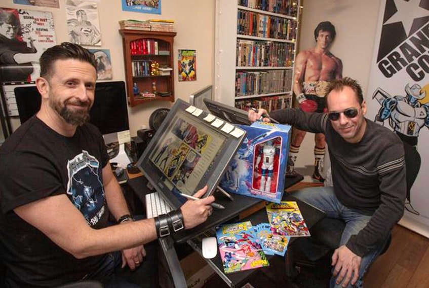 Derek Jessome, left, and Jeff Knott created their own comic books and their own comic book company and called it Grandway Comics. They are seen in their creative space looking over their original drawings and the finished product in Dartmouth on Thursday