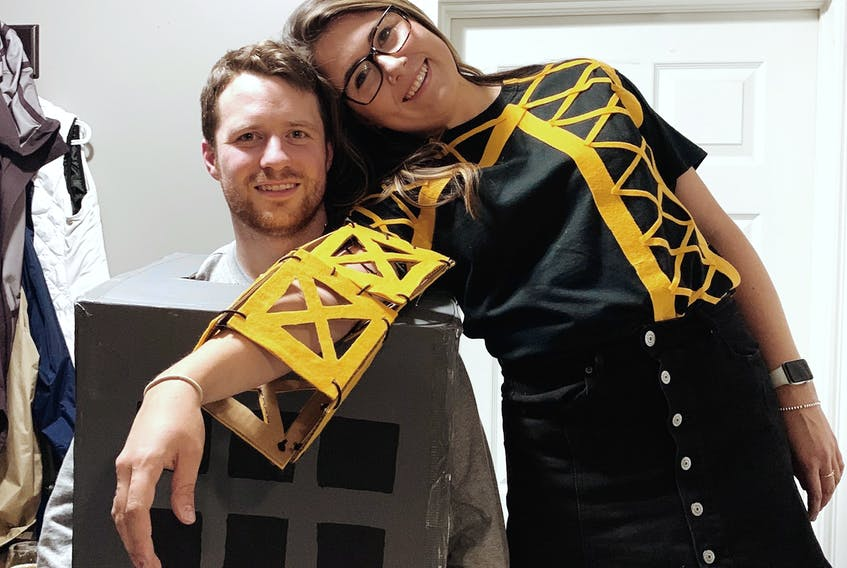 Nicole Bell and her partner Adam Higdon in their crane Halloween costumes. -ALEX PEDDLE - Contributed