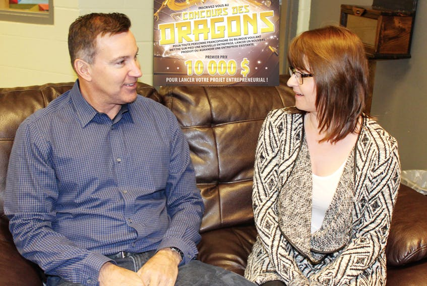 Velma Robichaud, co-ordinator of the 2018 Dragons' Contest, discusses the competition with sponsor Patrick Villeneuve, owner of Mermaid Marine Products in Charlottetown. The registration deadline is Jan. 31. SUBMITTED PHOTO