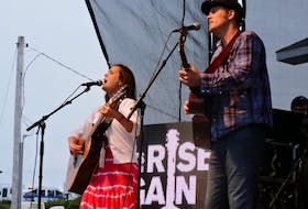 Maritime songwriters Jessica Rhaye and Dave Gunning perform together on the mainstage at the 2015 Stan Rogers Folk Festival. On Wednesday, organizers of the annual event that brings thousands of music fans to Canso each summer announced they were canceling the 2020 edition due to COVID-19 concerns.