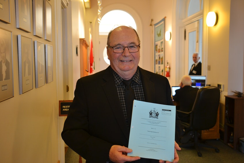 Montague-Kilmuir MLA Allen Roach holds a copy of the bill passed Friday that would ban single-use plastic bags. With its passing, the Island becomes the first province to legislate a ban on plastic bags.
