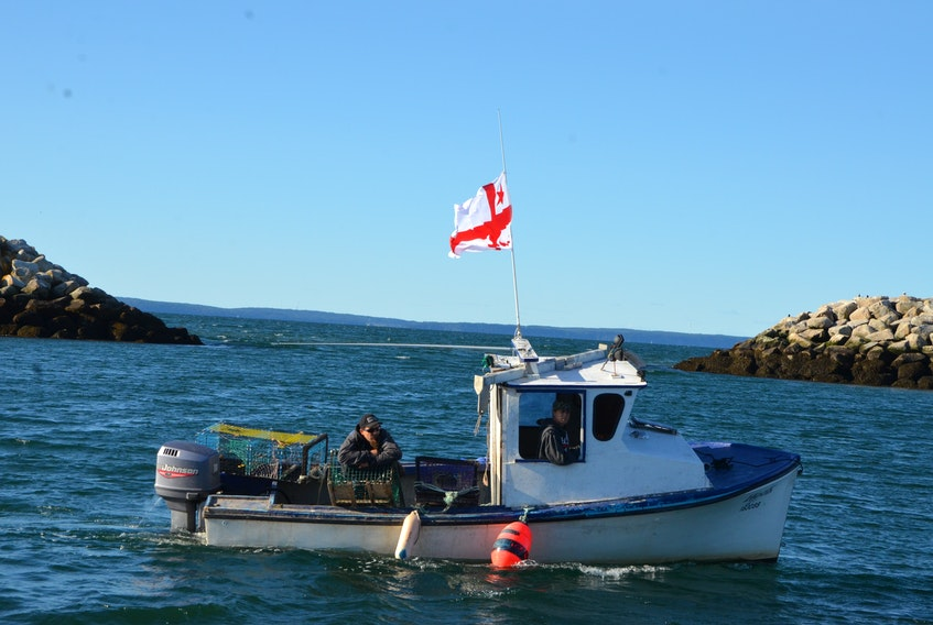 A Mi'kmaw owned fishing boat leaves the Lower Saulnierville wharf to set lobster traps under a moderate livelihood license.
