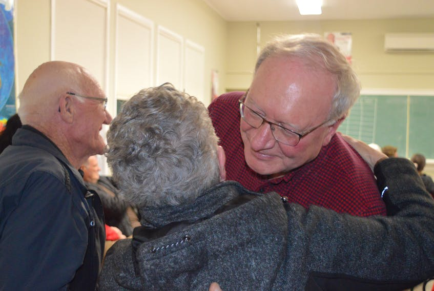 Liberal Leader Wade MacLauchlan consoles a supporter after he lost his District 8 Stanhope-Marshfield seat Tuesday night.