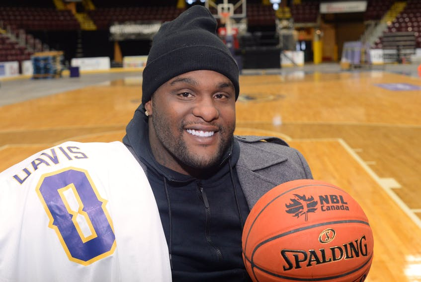 Foprmer NBA star Glen Davis poses on the court at Mile One Centre after officially signing with the St. John's Edge Wednesday afternoon. Davis, who won an NBA championship with the Boston Celtics, will be in the Edge lineup Friday night at Mile One for a game against the Island Storm.
