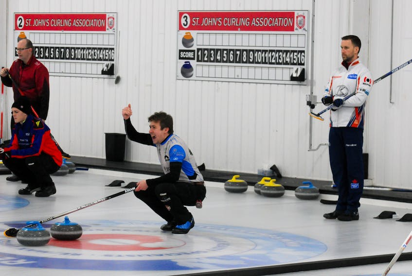 Skip Greg Smith urges on his sweepers as opposing skip Brad Gushue looks on during the first end of their round-robin game Friday afternoon in the 2020 Tankard provincial men's curling championship at the Re/Max Centre in St. John's. Gushue, a 13-time Tankard winner, made pretty quick work of his game versus Smith, the 2018 provincial champ, scoring five in the third end and stealing more in the fourth, leading to the game being conceded. The 8-0 victory kept Gushue undefeated and clinched his team a place in the three-team medal round this weekend. — Joe Gibbons/The Telegram
