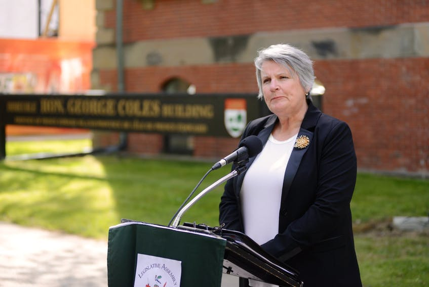 Finance Minister Darlene Compton speaks to the media outside the legislature on June 17, 202 after delivering her 2020 budget address.
