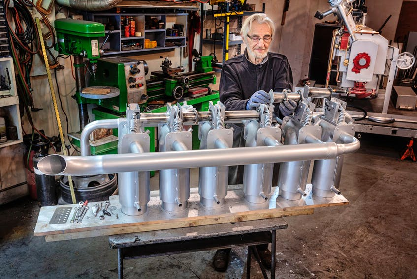 Kerwin Davison works on his replica of a 375-horsepower Rolls Royce engine that would've been like that on the Handley Page Atlantic bomber that made an emergency landing in Parrsboro in July 1919. Lawrence Nicoll photo