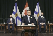 Derek Mombourquette signs his oath of office after being sworn in as Nova Scotia's education minister on Feb. 13. -- Communications Nova Scotia
