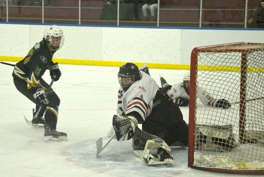 Jack Cameron of the Pictou County Scotians, right, makes a left pad save on Jacob Denny of the Eskasoni Eagle during Nova Scotia Junior Hockey League playoff action at the Dan K. Stevens Memorial Arena in Eskasoni on Tuesday. Pictou County won the game 6-5 in double overtime, advancing to the Sid Rowe Division semifinal series against the Antigonish AA Munro Bulldogs.