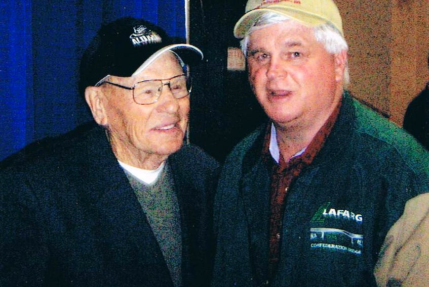 Toronto Maple Leafs goaltending great Johnny Bower, left and Tom Guinan are seen at the Halifax Forum in 2002.