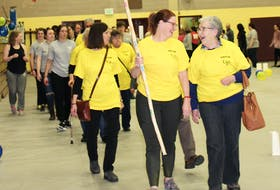 """Cancer survivors lead off this year's Relay for Life with the first lap of the track at the Mount Allison athletic centre. """"This was an important building year, and we realize that there is a lot of room for growth in terms of building the number of participants and awareness of the event,"""" said student organizer Jaden Snethun."""