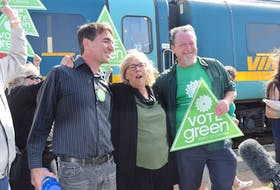 Jason Blanch at left, the Green Party candidate for Cumberland Colchester, is seen with party leader Elizabeth May and Barry Randle, the candidate for Central Nova, greeting supporters during a brief stop May made in Truro on Wednesday 's Green Party Candidate.