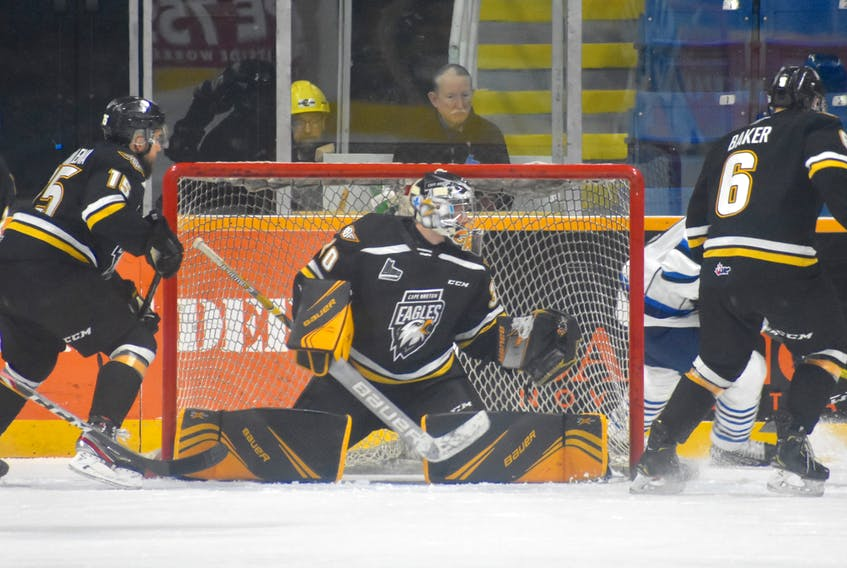 Cape Breton Eagles goalie William Grimard spreads out across his net while flanked by defencemen Kyle Havlena, left, and Jarrett Baker during first period action against the Chicoutimi Saguenéens at Centre 200 on Sunday. Chicoutimi won the game 2-1.