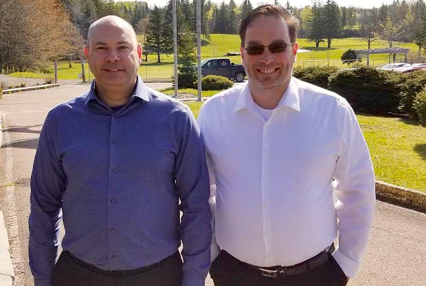 Chief marketing officer Pat Laderoute, left, and CEO Todd Chant are rolling out Easy Golf Tour's product, first in Canada and then in the United States.
