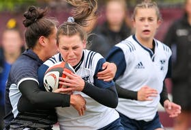 Hannah Ellis of the St. Francis Xavier X-Women breaks through a tackle against the Guelph Gryphons during quarter-final play at the 2019 U Sports women's rugby championship on Oct. 30 in Ottawa.   U SPORTS
