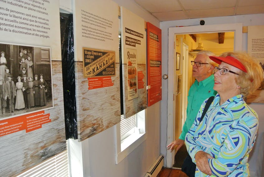 Phyllis Simms and her husband, Jeremy, from Mahone Bay look at the Enemy Aliens: Internment in Canada, 1914-1920 exhibit at the Cumberland County Museum following its opening on July 27.