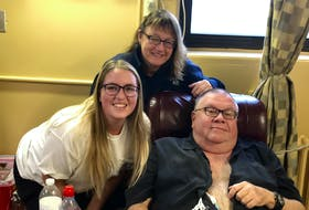 Evan, Gretchen and Bruce Phinney are shown last year in Halifax. Evan and Gretchen are collecting blood donation pledges to honour Bruce's memory. He died on Christmas Day in 2019.