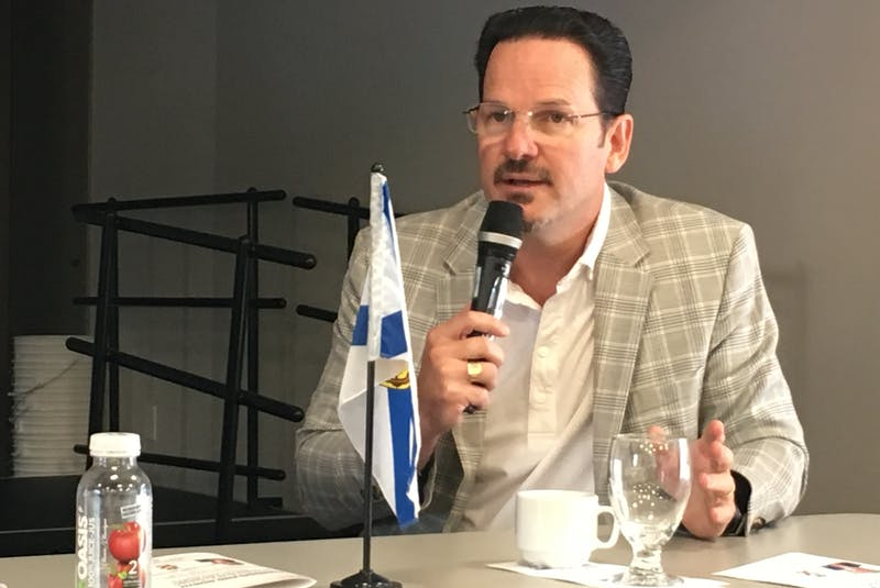 Stephen Emmerson, president and CEO of Emmerson Packaging, speaks to a business audience during a panel discussion at the Community Credit Union Business Innovation Centre on Thursday. - Darrell Cole
