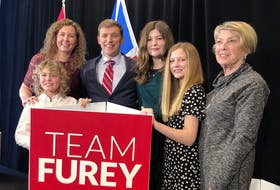 Liberal Leader Andrew Furey (third from left) celebrates his party's victory in the 2021 Newfoundland and Labrador election. With him are son Mark, his wife Dr. Allison Furey, daughters Maggie and Rachel, and his mother Karen Furey.
