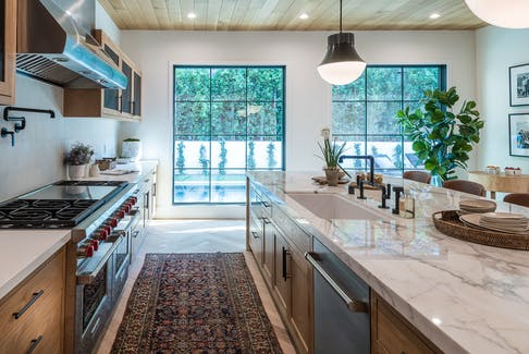 Consider the pros and cons of counter material options before your next home renovation project. - Watermark Designs Photo.