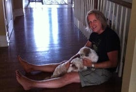 Jamie Almeda is shown here with his beloved dogs, Lola and Paola. - Photo Contributed.