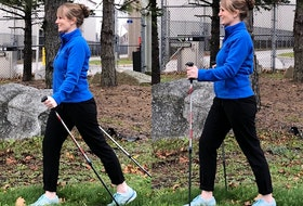 If walking poles are new to you, it's a good idea to get some formal training on their use. Physiotherapist Laura Lundquist is shown here demonstrating Nordic walking (left) and the Activator technique (right). - Photo Contributed.