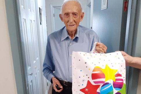 Ches Bull received a special package on his 100th birthday. - Photo Contributed.