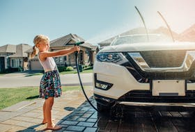No pool? No problem! Washing the car is a great way to cool off. - Photo 123rf.