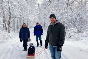 Far be it from me to tell these good people what to do, but wouldn't this make a stunning Christmas card?  Sharon and Paul Fudge were out for a stroll with their son, Shane, and Grandson, Wes, at the Old Town Site in Gander, N.L.  Someone had to take the photo, so Wes's mom Katherine stepped up to capture the magic.