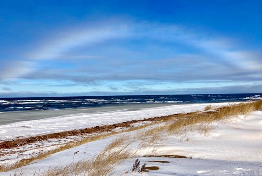 """Barbara Rousseau captured this rare ice bow while out for a drive along the Island's north shore earlier this month.  She watched as the clouds moved off just enough to create this """"ice bow"""" at the Covehead Harbour Lighthouse. It's is Barbara's first winter in P.E.I.  Barbara has observed that """"there is a lot of cloudy weather, so it's great when we get sunshine and see the changes at the shore."""