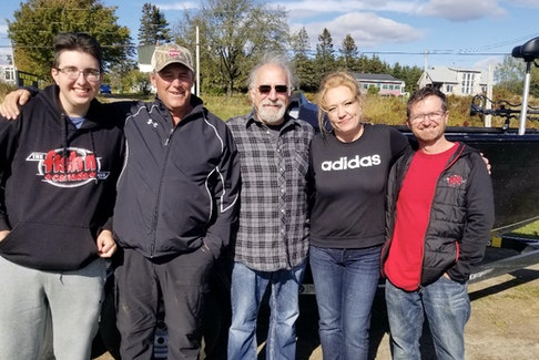 From left, Angelo Viola's grandson Nik; Greg Belliveau, owner/operator and captain of Bass Barn Fishing Charter and Tours; TV host Angelo Viola; Amanda Perry, Greg's wife and co-owner and operator of the tours; and co-host Peter Bowman.