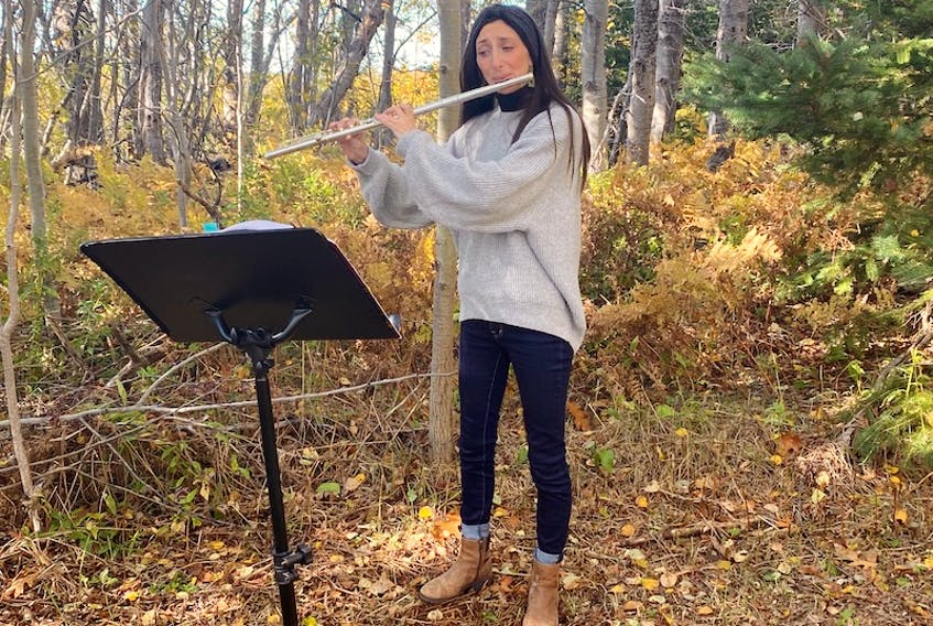 Flutist Morgan Saulnier is shown performing at Tuning into Nature in Tryon earlier this month.