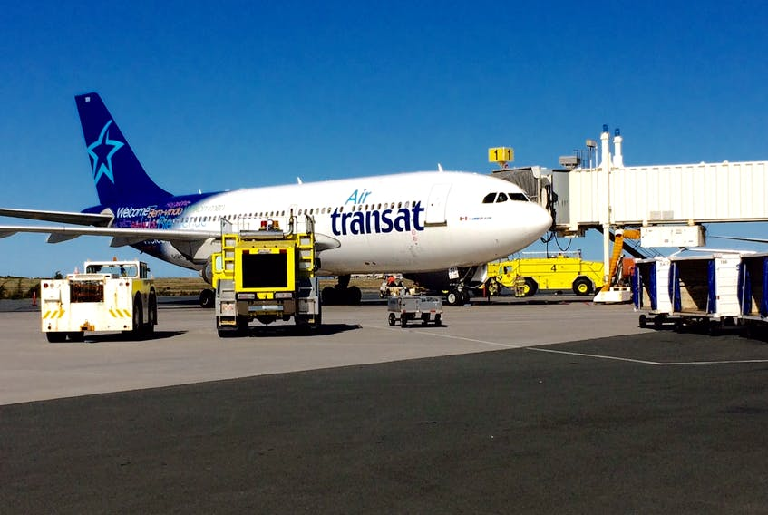 An Air Transat plane enroute from Barcelona to Montreal was diverted to St. John's airport Monday with fire crews on standby.