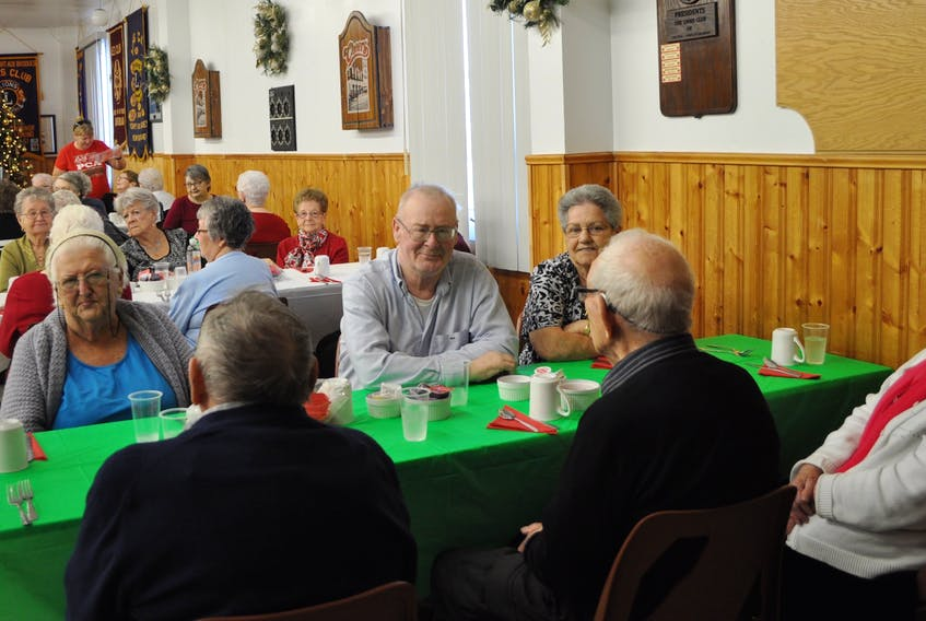 Seniors in residence at the retirement home and hospital were treated to a Christmas dinner on Dec 4, co-sponsored by East Haven Funeral Home and the Port aux Basques Lions Club. - J.R. Roy/Special to The Gulf News