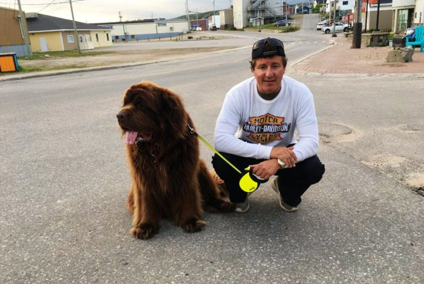 Milwaukee resident Craig Klover poses with his seven-year-old Newfoundland dog, Rocky.