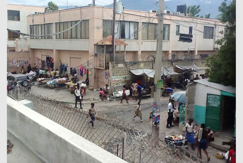 Just outside the wall of the medical compound lies a juxtaposition of everyday life in Haiti.