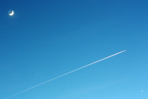 Thank you to Michael Boschat for this photo of the moon and a jet trail over Halifax, N.S.