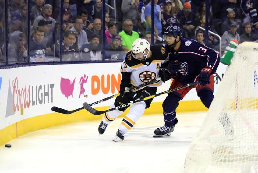Boston Bruins centre Patrice Bergeron skates against Columbus Blue Jackets defenceman Seth Jones in the third period during Game 4 of the second round of the 2019 Stanley Cup Playoffs at Nationwide Arena, May 2, 2019 in Columbus, Ohio. - Aaron Doster / USA TODAY Sports