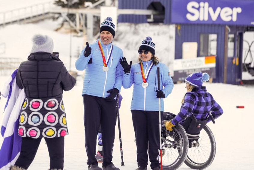 Brenda MacDonald, right, and her father Stephen, who was her guide, pose for a photo after winning the silver medal in the para giant slalom at the Canada Winter Games on Tuesday.
