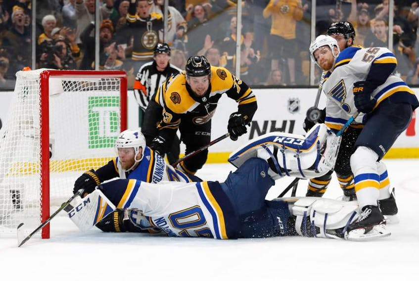 St. Louis Blues goaltender Jordan Binnington (50) and defenceman Carl Gunnarsson (4) collide as defenceman Colton Parayko (55) and Boston Bruins defenceman Charlie McAvoy (73) watch the puck bounce away during the third period in game five of the 2019 Stanley Cup Final at TD Garden on Thursday, June 6, 2019. - Winslow Townson / USA TODAY Sports