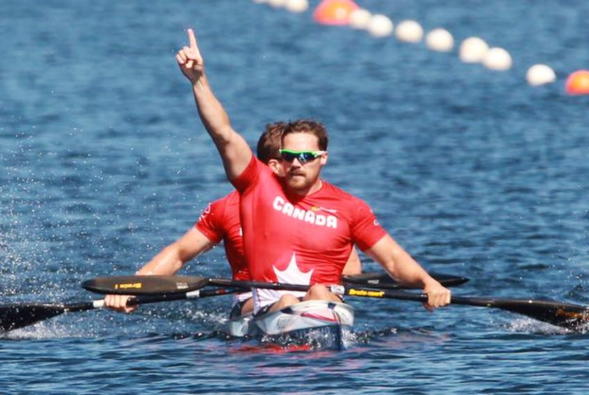 Canada's Mark De Jonge, front, with teammate Alex Scott celebrate after winning the senior men's K-2 200-metre final at the Pan Am and Para sprint canoe championships on Lake Banook in Dartmouth on Friday.