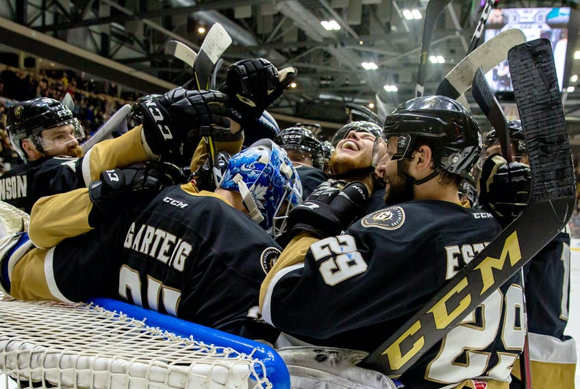The Newfoundland Growlers celebrate their Eastern Conference championship with goalie Michael Garteig after beating the Florida Everblades 3-0 Saturday night at Mile One Centre.