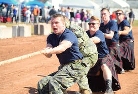 Brent Garnhum lets out an almighty heave during the tug of war match at the 2018 Colchester Highland Games and Gathering in Truro on Sept. 8. Festival-goers enjoyed heavyweight games such as Braemar stone hurling, a tartan bagpipe band performance, live music from Scottish band Clann an Drumma and a historical re-enactment of the Battle of Culloden, among other attractions.
