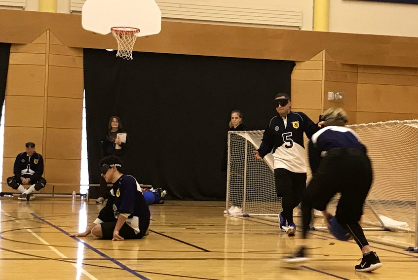 Peter Parsons (number five) moves into position on the court for Team Nova Scotia.