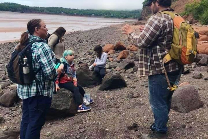 Brian Hebert leads a tour on the beach at Joggins. Hebert and his wife, Laura Thompson, were looking forward to another big year for Fundy Treasures Gifts and Tours until COVID-19 spun the tourism industry on its head.