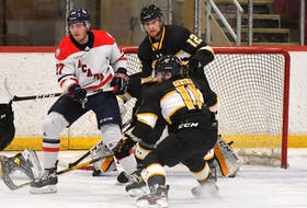 Acadia Axemen winger Tyler Hinam screens the Dalhousie goalie during an AUS exhibition hockey game last month in Wolfville. Cole Harbour's Hinam is in his first season at Acadia after a successful QMJHL career. - Peter Oleskevich / Acadia Athletics