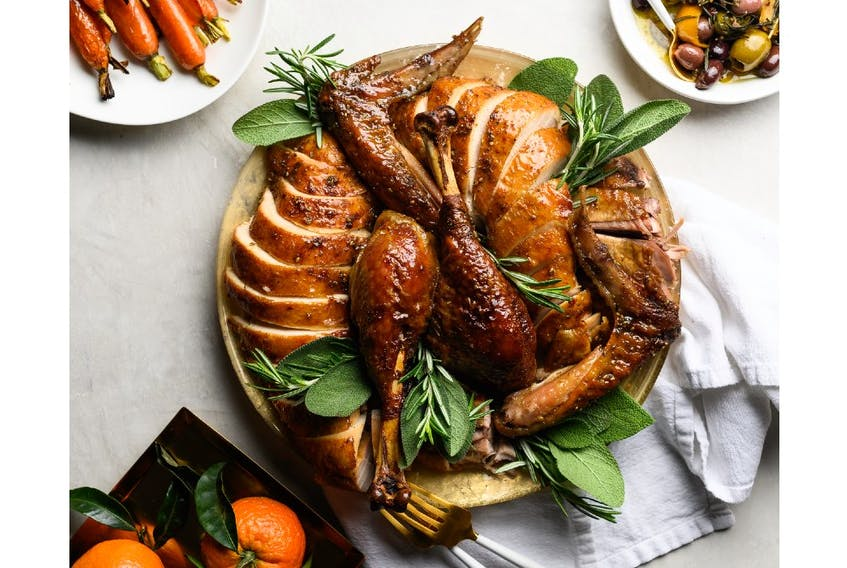 This Middle Eastern inspired za'atar and honey-glazed roasted turkey is the showpiece of a multicultural inspired Thanksgiving table. - Turkey Farmers of Canada