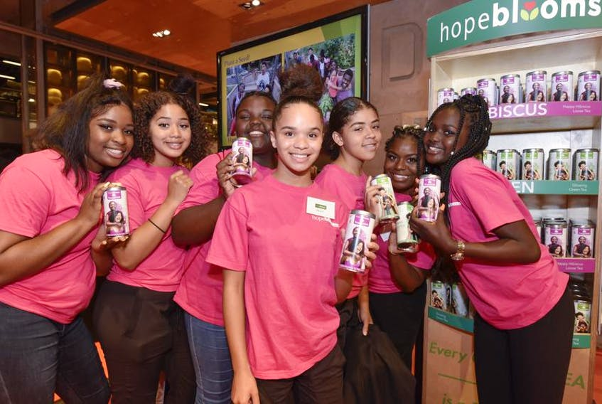 Representatives of Halifax's Hope Blooms social enterprise for youth were in Toronto last week to launch the sale of Possibili-Teas specialty teas and Hope Blooms fresh herb dressings at the Loblaws grocery store in Maple Leaf Gardens. The tea team included Folayemi Boboye, left, Kitana Gray, Anisa Barton, Jade Driscoll, Kayleigh Bowes, Barbara Loppoe, and Aicha Wade.