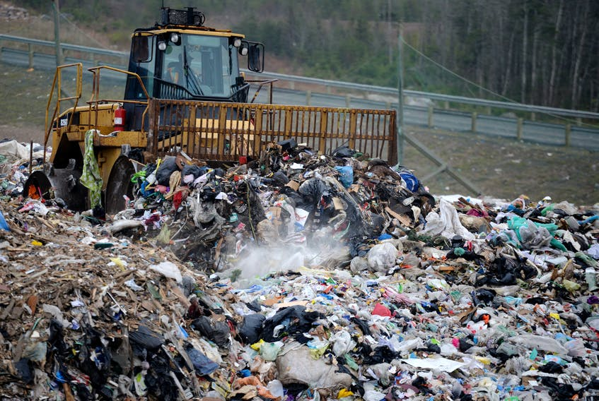 December 9, 2014--Garbage is moved in place at the Otter Lake Landfill site on Tuesday. (INGRID BULMER/Staff)